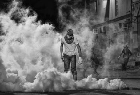 The winning photo chosen by Freedom House showing a Bahraini protestor standing in a cloud of teargas after suppressing a peaceful gathering he had participated in