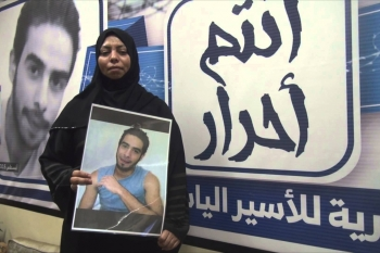 Mother of Elias Al-Mulla Carrying his photo